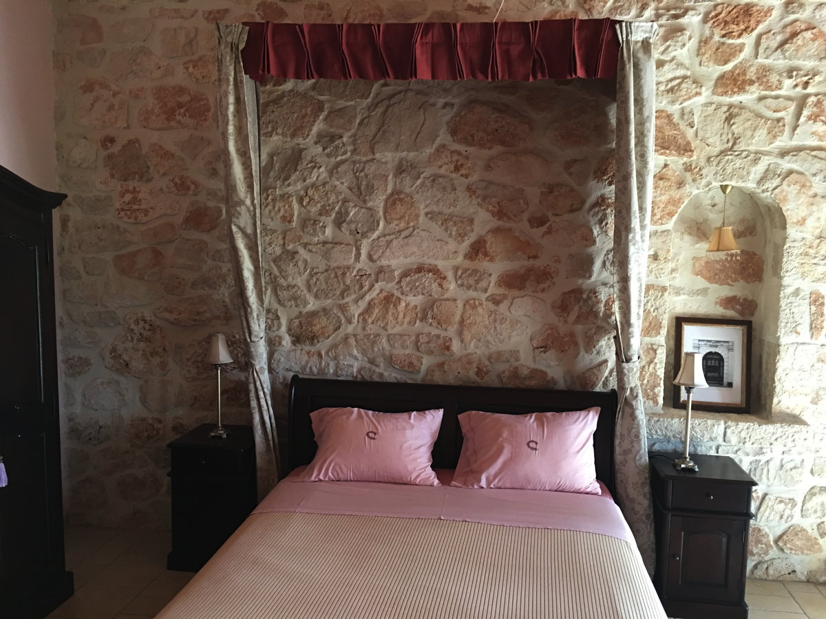 Spanish Parador style bed of Hestia suite